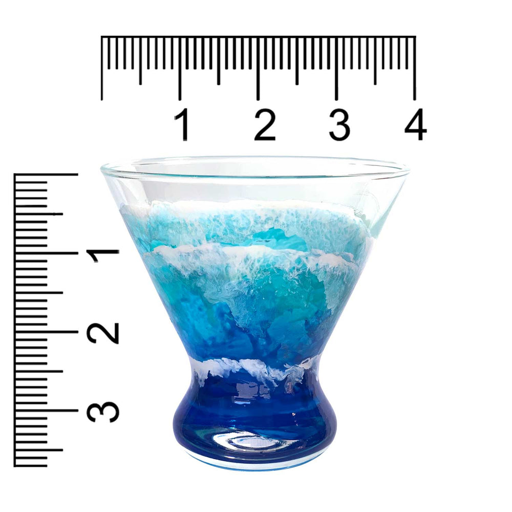 Custom hand-painted martini glass with blue and white ocean waves. Shown with size scale in inches.