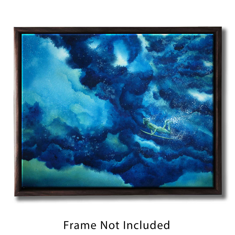 Framed ocean wall art of a surfer diving beneath a rolling blue wave