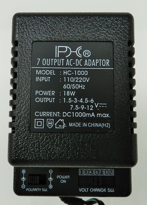 AC-DC Universal Power Adapter Multi Voltage Output: 1.5VDC-12VDC @ 1000 mA; 7-plugs; Part #  HC-1000