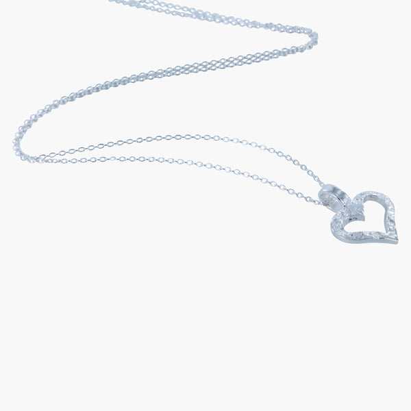 Sterling silver open hammered heart pendant on a silver chain