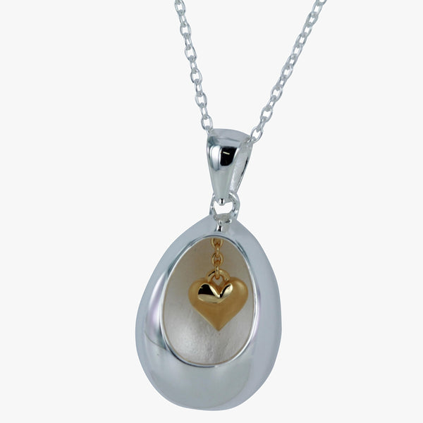 Sterling silver egg pendant on a silver chain with hanging gold vermeil heart inside the chain