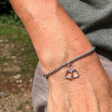 Sterling Silver Beaded Bracelet with Double Stirrup Charm
