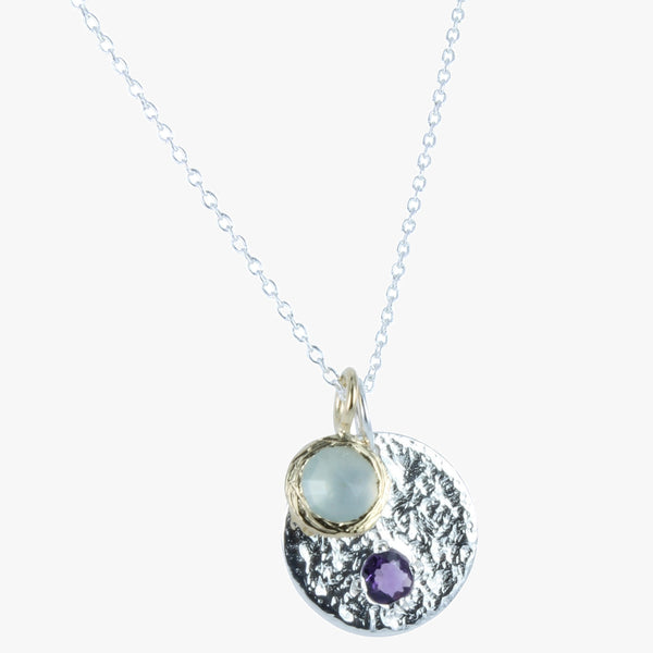 Sterling silver hammered disc with amethyst stone and an aqua stone in gold vermeil bezel on a silver chain