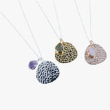 Sterling silver hammered disc in silver, rose and yellow gold with amethyst, labradorite and moonstone on a silver chain