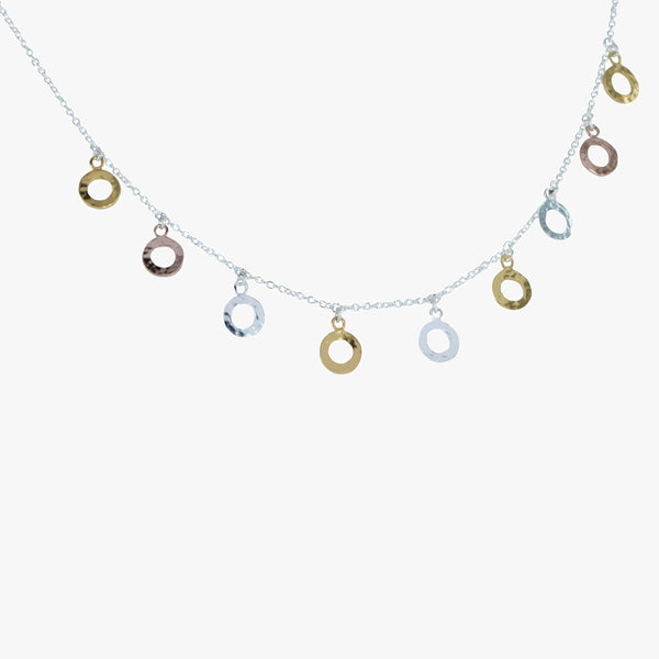 Sterling silver chain necklace with hammered discs in rose gold, yellow gold vermeil and silver hanging off the chain