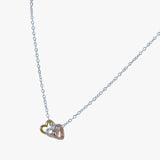 Sterling silver silhouette heart charms on a silver necklace. In silver, yellow and rose gold vermeil
