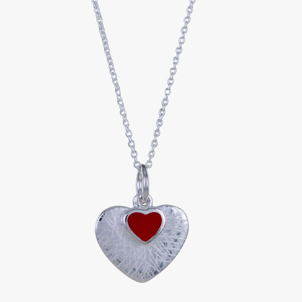 Sterling silver scratched heart with a red enamel smaller heart on top. On a silver fine chain