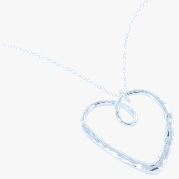 Sterling silver Hammered heart pendant on a silver chain