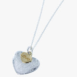 Sterling silver scratched heart with 18ct gold vermeil disc with 'love' hanging from a silver chain