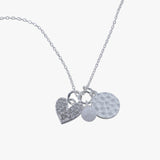 Sterling silver hammered disc, pearl and cubic zirconia heart charm on a silver chain
