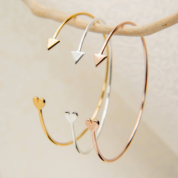Sterling silver bangle with 18ct yellow or rose gold vermeil. 'Cupid' due to arrow and heart design on ends of the bangle