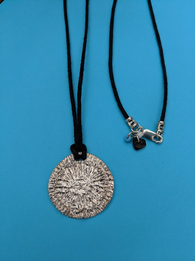 Large or Small Sterling Shark Disc Strength Pendant on looped black cord.