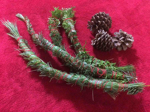 Make seasonal smudge sticks for your Yule celebrations.  Patti Wigington