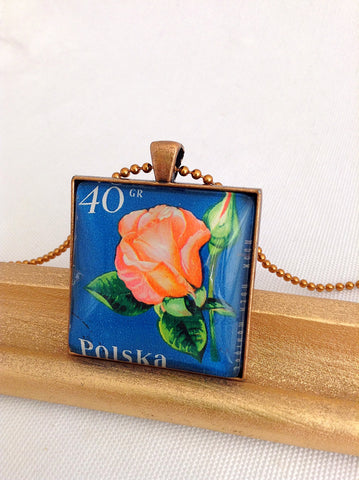 vintage postage stamp necklace created by Starzyia, using a rose postage stamp from Polska, Poland