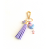 our faux suede tassel in soft pastel lavender is teamed with sparkling beads and the most gorgeous turquoise magnesite bead to create a boho accessory you will love