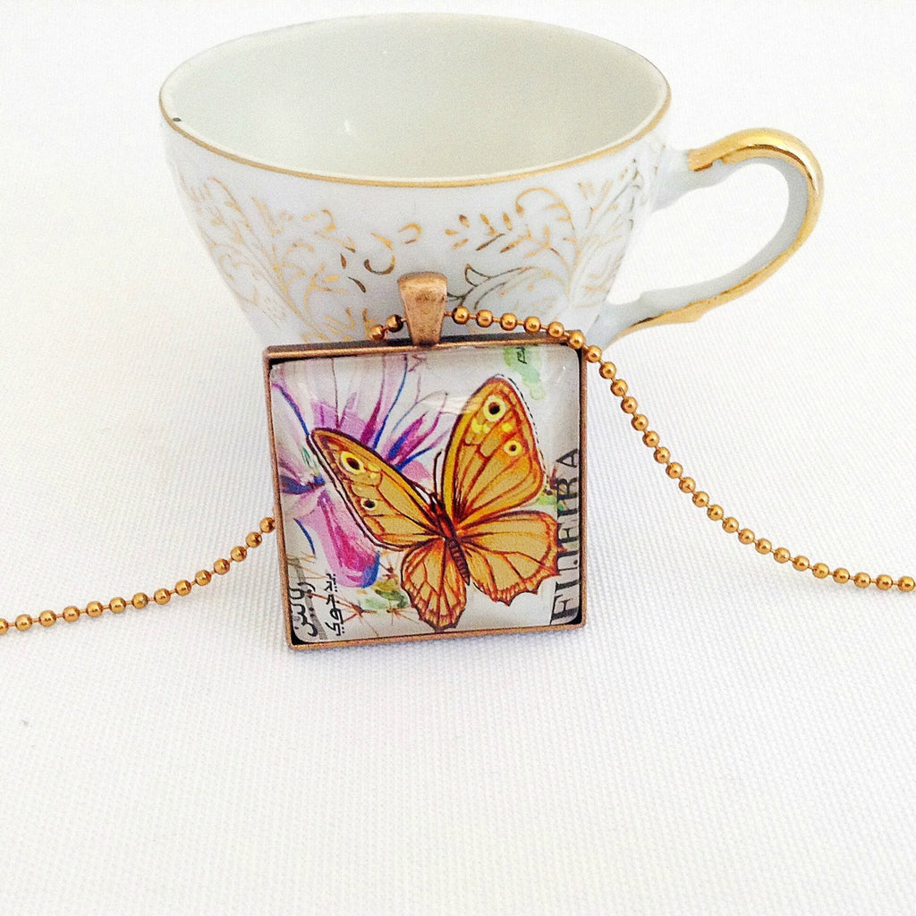 golden butterfly necklace, vintage postage stamp pendant, 1967 - StarzyiaVintage Postage Stamp Jewellery