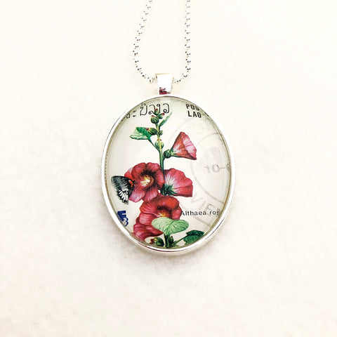 hollyhock flower necklace, 1988 Laos postage stamp - StarzyiaVintage Postage Stamp Jewellery