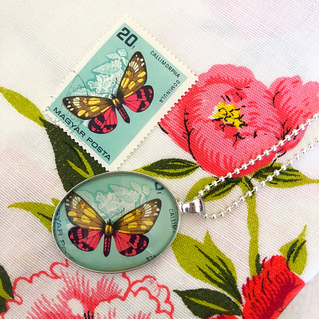 we take original vintage postage stamps to create our handmade pendants, this one is a bright and beautiful butterfly from 1966