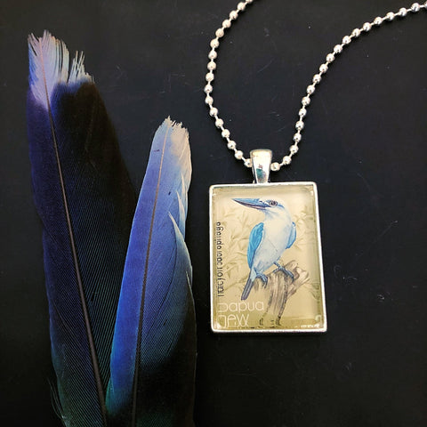 kingfisher bird pendant, postage stamp necklace featuring 1981 vintage Papua New Guinea - StarzyiaVintage Postage Stamp Jewellery