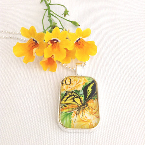 yellow butterfly necklace, 1975 postage stamp from Papua New Guinea - StarzyiaVintage Postage Stamp Jewellery