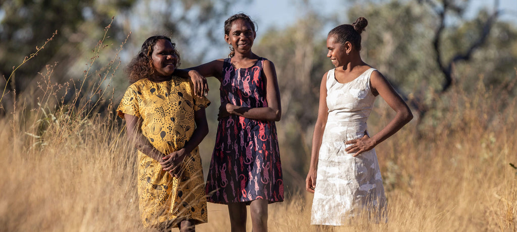Minyerri girls posing in Magpie Goose clothes . On Alawa Country, Northern Territory