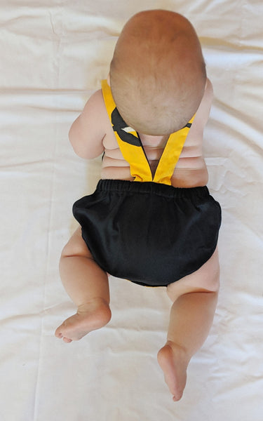 Baby romper - Murnubbarr Karrolka (flying magpie geese) yellow/black