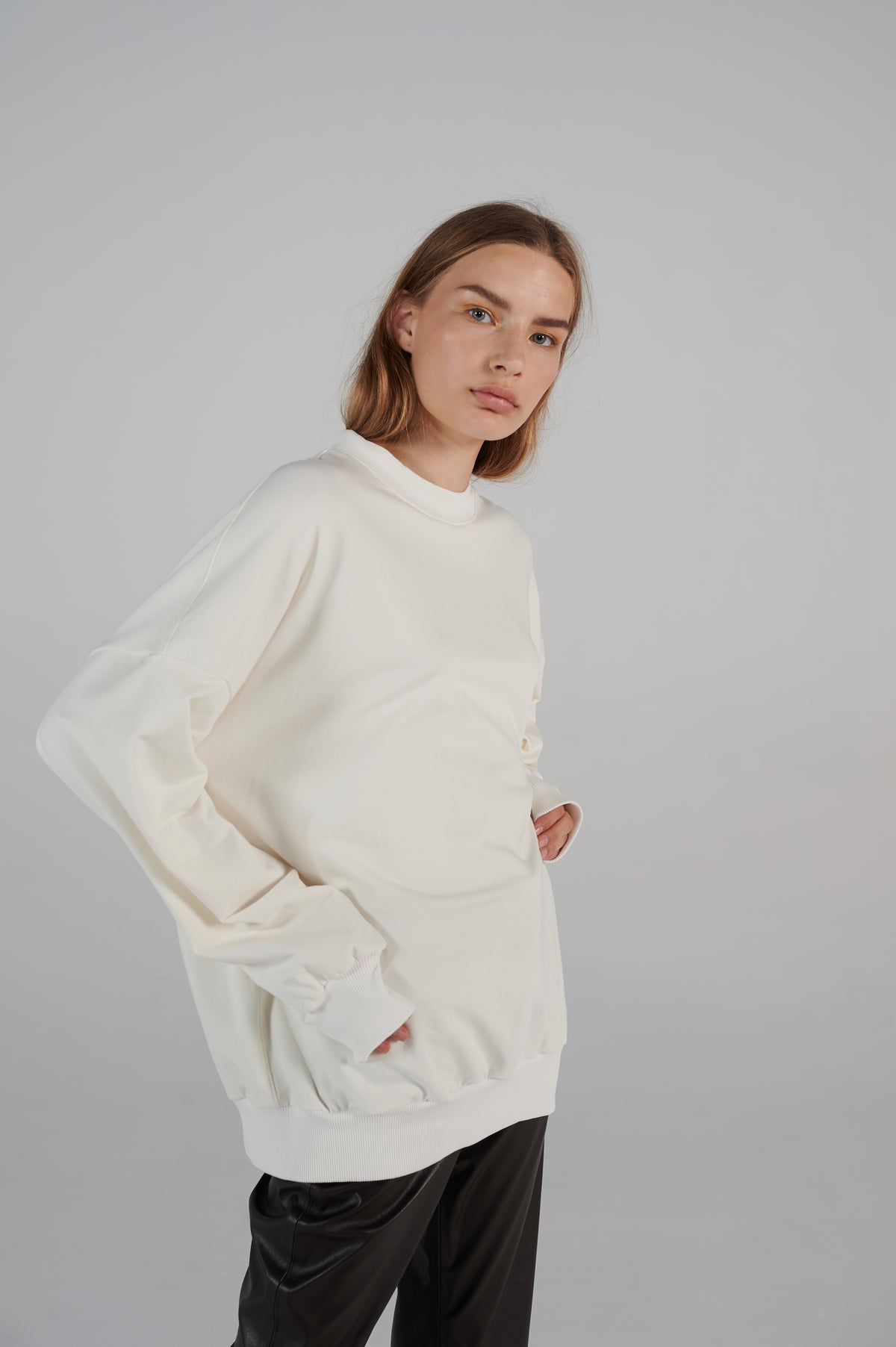 boxy-shape-white-sweater-with-red-logo-on-the-back-lookbook.jpg