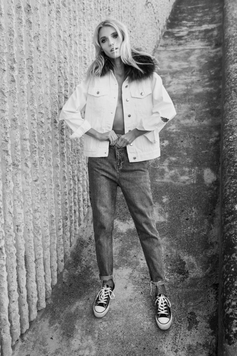 Abbey Lee Kershaw standing posing for the camera