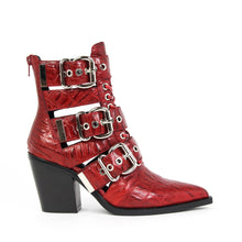 JEFFREY CAMPBELL Caceres Cutout Buckle Bootie Red Croc Print. Stand out in the Jeffrey Campbell Caceres pointed-toe bootie in red crocodile embossed kid leather, featuring gleaming silver buckles and hardware punctuated by a lace-up belted shaft on a pointed-toe and set on a stacked block heel. Free National Shipping.