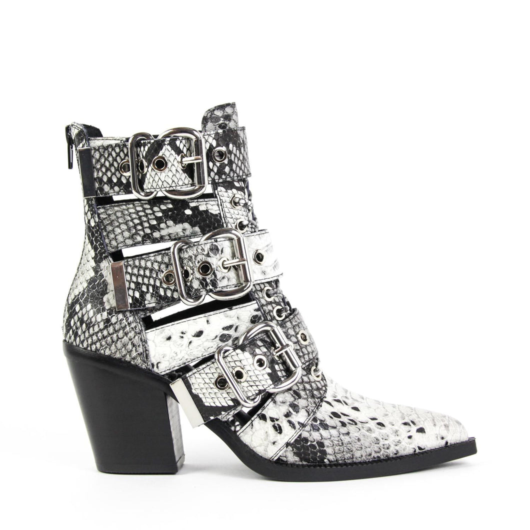 Stand out in the Jeffrey Campbell Caceres pointed-toe bootie in black and white snake print leather, featuring gleaming silver buckles and hardware punctuated by a lace-up belted shaft on a pointed-toe and set on a stacked block heel. Free National Shipping. Afterpay and ziPpay available.