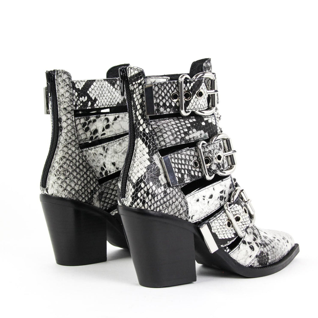 a50b9a6ef549 ... Stand out in the Jeffrey Campbell Caceres pointed-toe bootie in black  and white snake ...