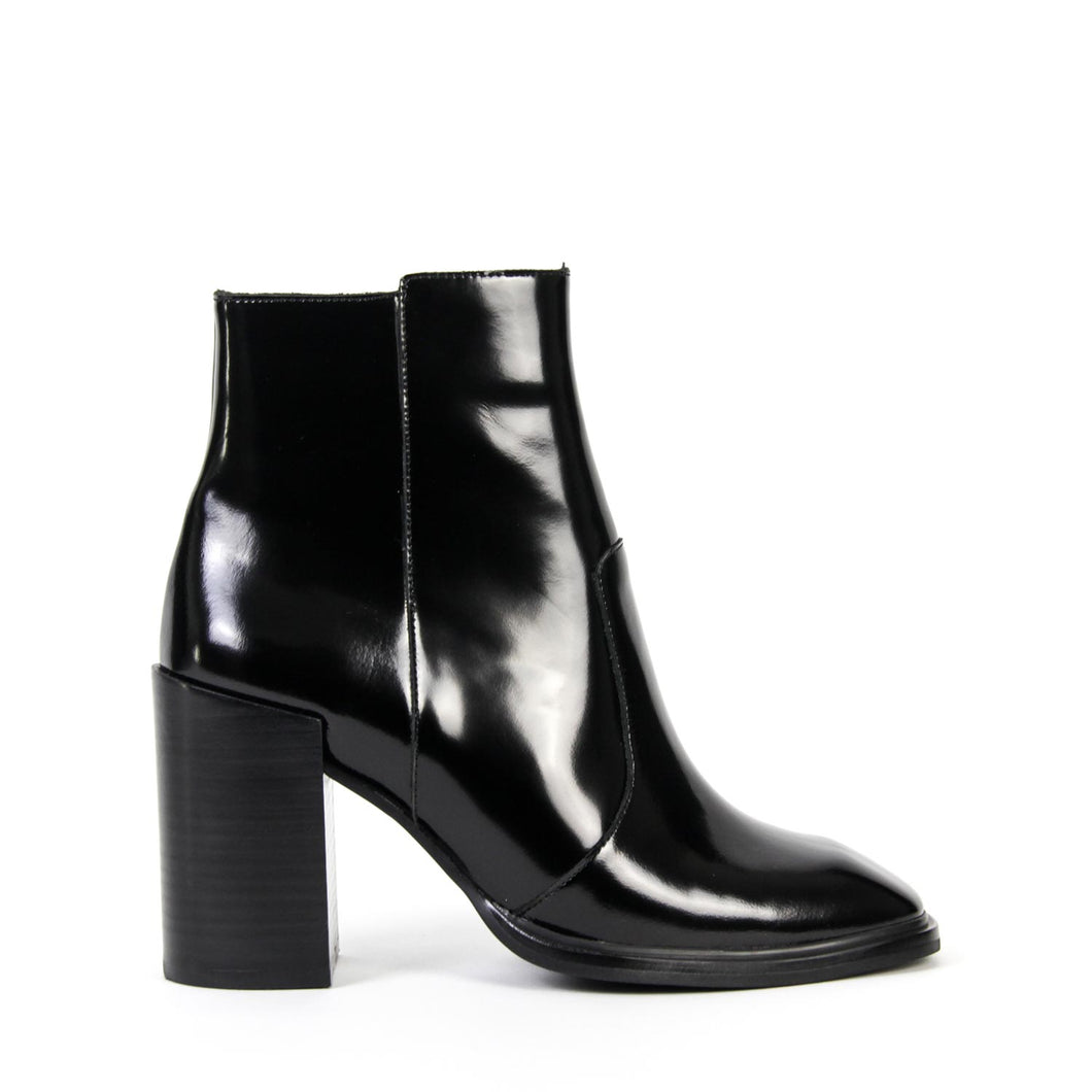 JEFFREY CAMPBELL FAIRFORD. Chisel Toe Ankle Boot. Black High Shine. Box Calf Leather. Leather Lined. Inside Zip Closure. 8.8cm Block Heel. Designed In California. Free, Fast Shipping Australia Wide On Orders Over $150. Afterpay & Zip Pay Available.