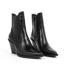 Jeffrey Campbell Johan Western Chelsea Boot in black calf leather featuring a pointed toe with elastic gore and zip closure on a stacked Cuban block heel. Free Shipping Australia Wide Over $150. Shop Now Pay Later Afterpay & ZipPay.