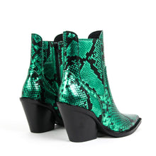 Jeffrey Campbell Johan Western Chelsea Boot in green metallic snake embossed leather featuring a pointed toe with elastic gore and zip closure on a stacked Cuban block heel. Exclusive to Amo Store. Free Shipping Australia Wide Over $150. Shop Now Pay Later Afterpay & ZipPay.