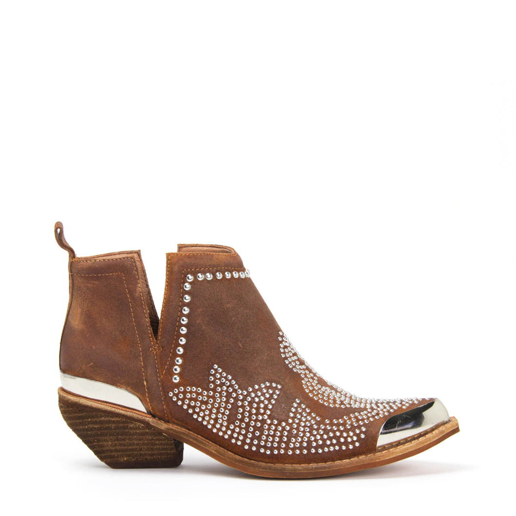 Jeffrey Campbell OXNARD ST Studded Western Cutout Ankle Boot in tan distressed suede. Pointed toe. Stacked 4.5cm Cuban heel, silver toe & heel rands. Shop Afterpay.