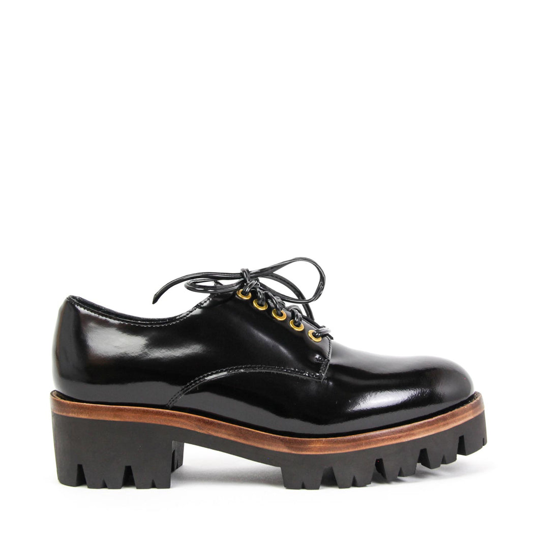The Jeffrey Campbell Trevor chunky platform women's derby shoe is crafted in black box calf leather and elevated by a heavily lugged sole on a chunky heel and finished with striking polished eyelets, leather laces and contrasting tan leather welt. Buy Now Pay Later Afterpay & zipPay Available. Free & Fast Shipping AU.