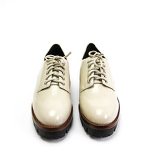 The Jeffrey Campbell Trevor chunky platform women's derby shoe is crafted in ivory box calf leather and elevated by a heavily lugged sole on a chunky heel and finished with striking polished eyelets, leather laces and contrasting tan leather welt. Buy Now Pay Later Afterpay & zipPay Available. Free & Fast Shipping AU.