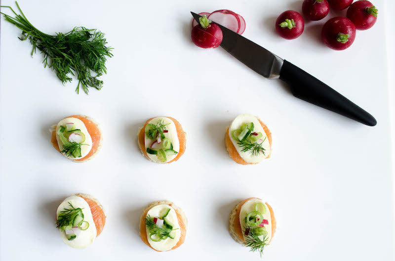 Blinis with cheese, salmon and dill