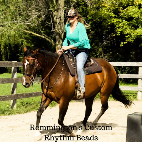 Remington cruizing around in his custom rhythm beads made by Natural Equine Connection.