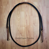 Our adjustable horse training rope neck with leather poppers are available with many options. The standard neck rope has a braided slider to easily adjust proper length. Many options available. Perfect for Bridleless and Liberty Training.