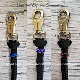 Customize your natural horsemanship rope training equipment with decorative leather or paracord braided knot accents in your choice of color. A great way to stand out of the crowd and identify your equipment easily. Hand crafted in Ontario, Canada by Natural Equine Connection.