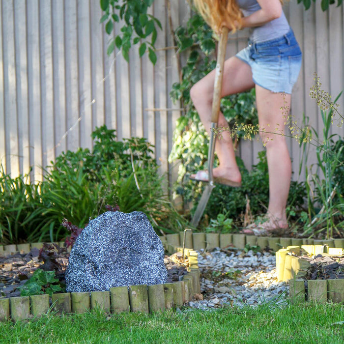 Lithe Audio Outdoor Bluetooth Rock Speaker that blends into garden environments