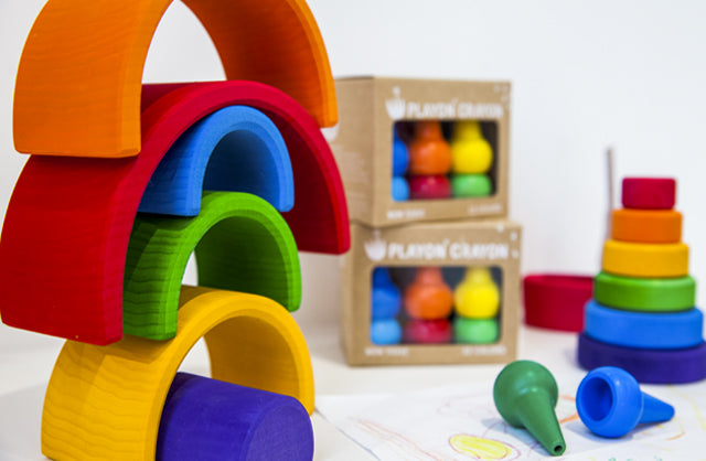 Kids wooden toys from Grimms and Plan Toys. Multicolour stacking rainbow for building and balancing.