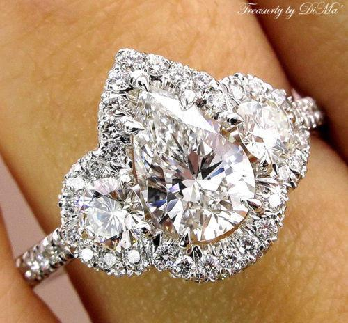 PEAR SHAPED DIAMOND THREE STONE WITH HALO ENGAGEMENT WEDDING RING | Treasurly by Dima - Exquisite Diamonds and Fine Quality Antique, Vintage, and Estate Jewelry