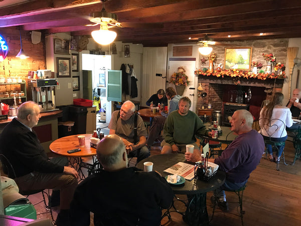 Customers chatting and eating breakfast at Homestead General Store