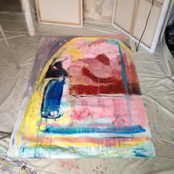 large abstract painting with pink, yellow, green, rusty red and charcoal on unstretched canvas