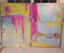 2 60 x 40 abstract paintings aside of each other in blue, yellow and pink