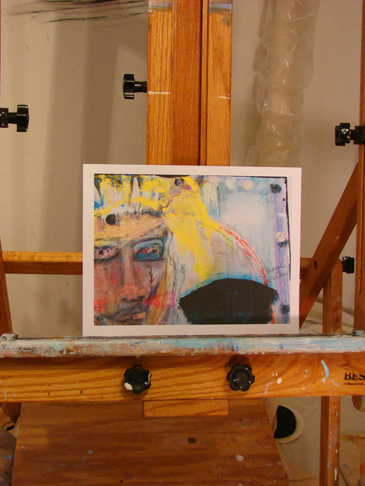 Bohemian abstract face of woman with blonde hair print on paper on easel