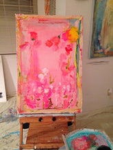 Pink, turquoise and yellow mixed media abstract painting on easel in art studio cherylwasilowart