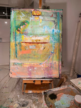 turquoise, green and orang and pink abstract painting on easel by artist Cheryl Wasilow